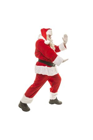 Santa Claus in a fighting stance on a white background
