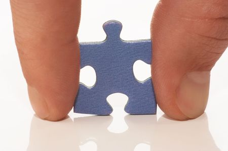 puzzle in hand on white photo