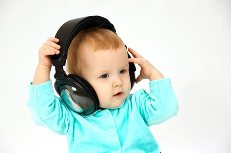 baby and head-phones Stock Photo