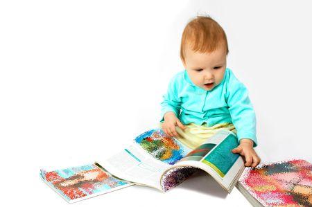 portraiture: baby read the magazine Stock Photo