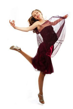 young beauty girl is dancing photo