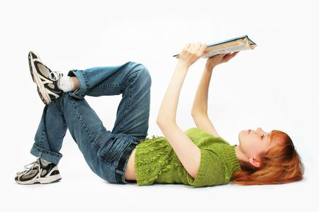 filly: young girl read the book on white Stock Photo