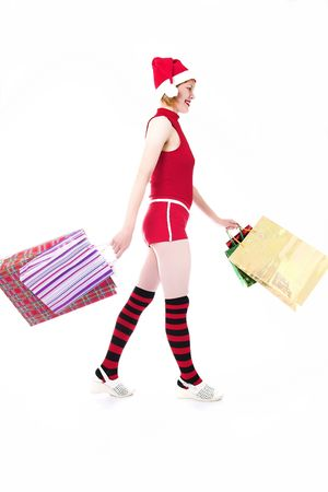 pretty girl in red and wear with gifts on white photo