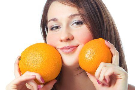 portrait pretty girl with two orange over white photo
