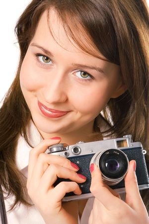 portrait pretty girl with photo camera over white photo
