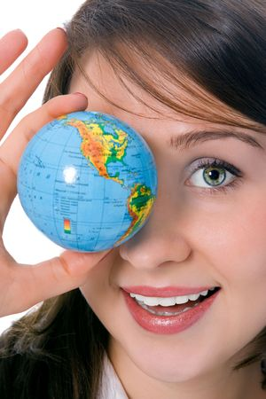 yung beauty girl hold globe in front of eye over white photo