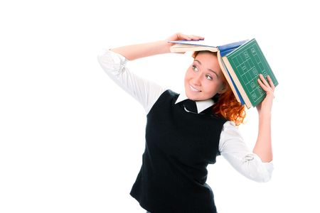 Young beautiful student girl with books on head on white background photo