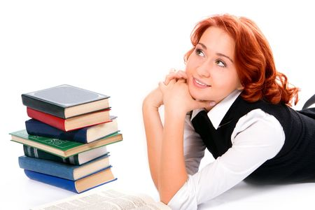 Young beautiful student girl with books on white background photo