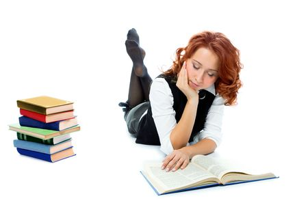 Young beautiful student girl read book on white background photo
