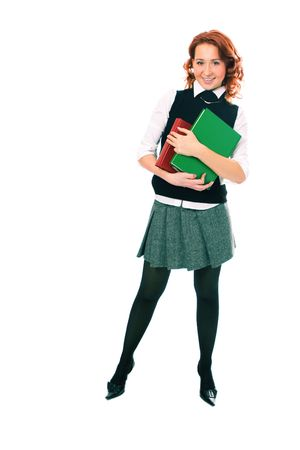 Young beautiful student girl with books in hand on white background photo
