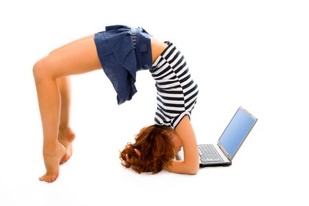 beauty girl stand on head with laptop on white background photo
