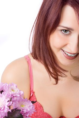 smiling girl with flowers on white photo