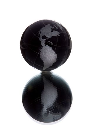 black globe with white continent over white background with reflection photo