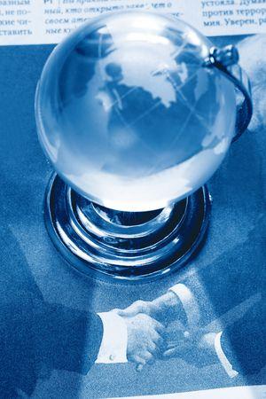 formulation: daily handshake under Earth globe on newspaper Stock Photo