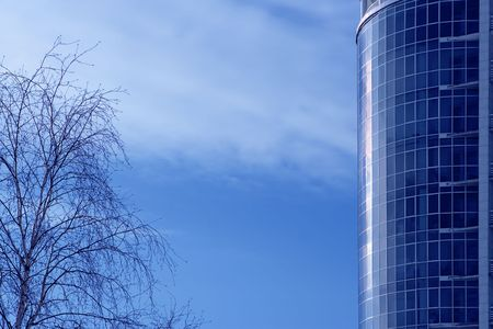 municipal utilities: business buildings on blue sky and clouds Stock Photo