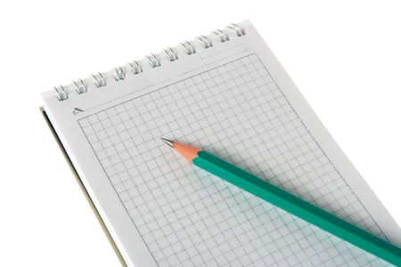 notebook and pencil on white photo