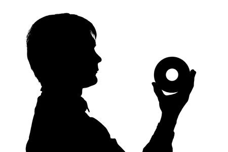 black silhouette man hol CD in hand on white background photo