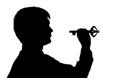 black silhouette man hold key on white background photo