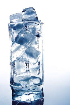 gauzy: brick of ice in the glass on grey Stock Photo