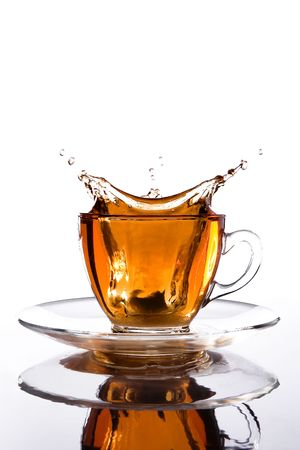 glass cup of tea withsplash out Stock Photo