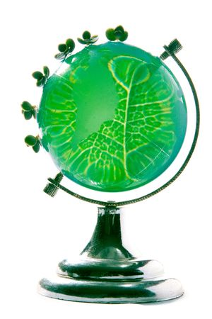 small plants on green peace globe with structure of leaf photo
