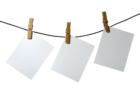 clothespeg: white paper clothes-peg rope over white background