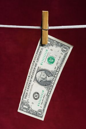 attach: one american dollar attach to rope clothes peg on red