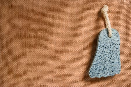 cian: cian pumice-stone on brown texture background Stock Photo