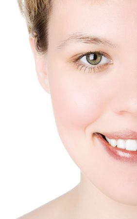 widely: close-ups Half face girl looks in staff and widely smiles a white teeth over white background