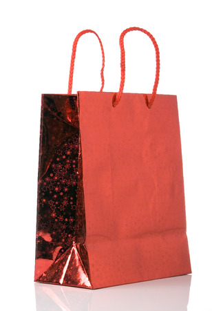 costumer: red paper bag isolated over white background Stock Photo