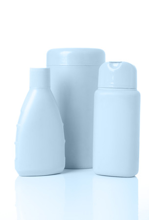 three blue cosmetics bottle with reflection on white Stock Photo - 1398323