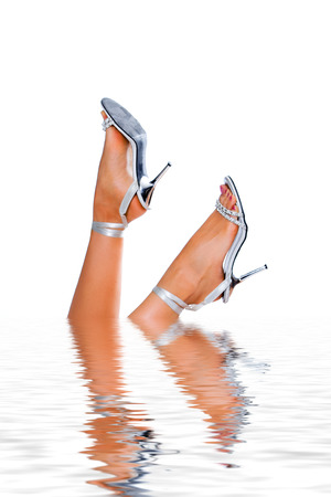 distortion: Woman legs in water on white background Stock Photo