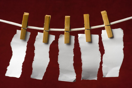 attach: scrap paper attach clothes-peg to rope on venous background