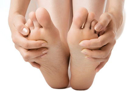woman massage feet on white Stock Photo
