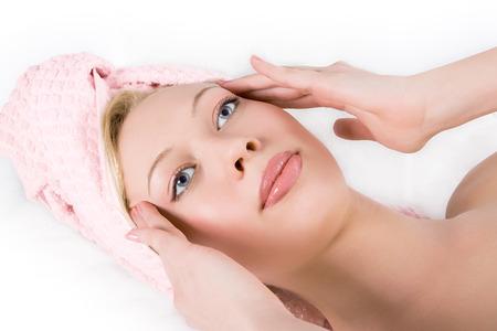closeups: blonde girl facial massage on white background