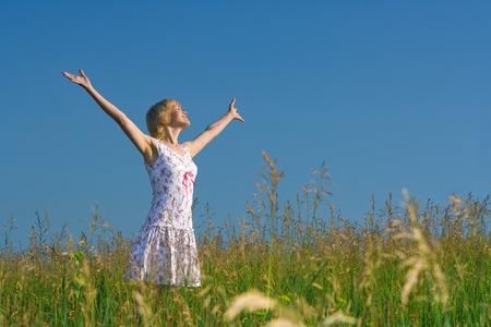 Beauty happy woman in field relaxing Stock Photo - 1399042