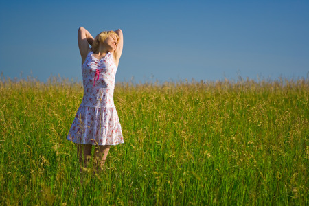 Beauty happy woman in field relaxing Stock Photo - 1399050