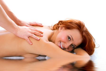 bodyscape: man hand massage beauty redheaded girl on white background