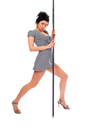 attractiveness: beauty brunette girl dance strip-tease on white background
