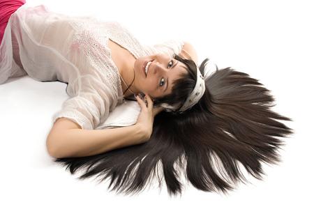 sorcery: portrait beauty Eastern brunette woman on white background Stock Photo