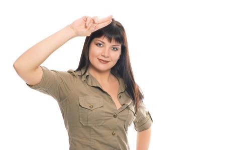 sorcery: beauty brunette soldier girl salute on white background