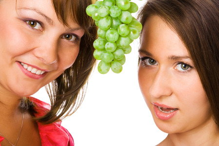helthcare: happy couple woman with grapes on white