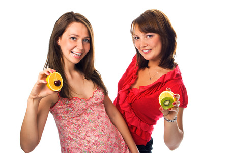 helthcare: two young woman with fruit on white Stock Photo