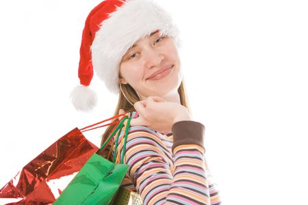 young  christmas girl in red hat with package over white background photo