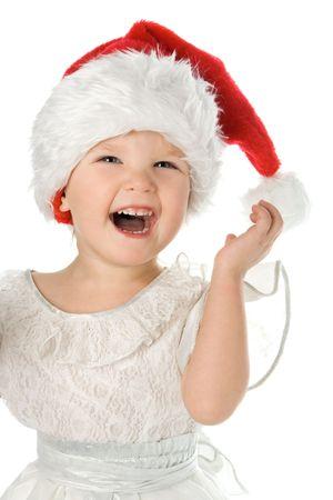 pretty baby in Babbo Natale natale cappello rosso su sfondo bianco  Archivio Fotografico