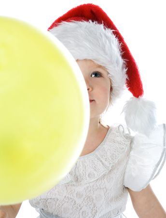 pretty  in santa claus christmas red hat with balloon over white background photo