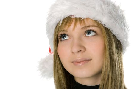 close up of girl face in Santa hat over white background photo
