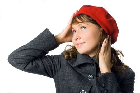 outer clothing: Portrait of beautiful girl in outer clothing and beret over white background