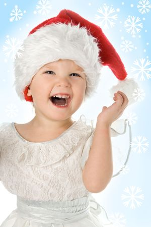 pretty  in santa claus christmas red hat and snowflake on blue photo