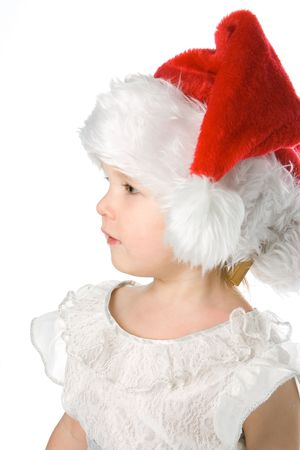 pretty baby girl in santas hat over white background photo